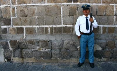 A private security guard stands watch in Guatemala City