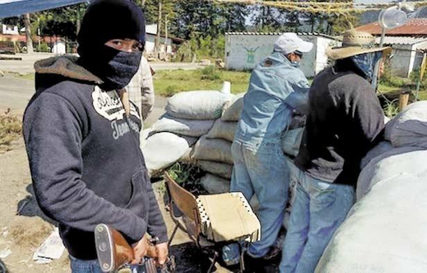 Bolivian police examine a seized stolen vehicle