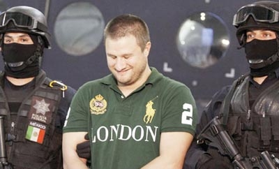 """La Barbie"" smirks after his arrest in 2010"
