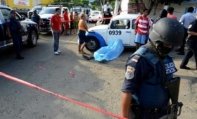 Police inspect the scene of a murder in Acapulco, Mexico