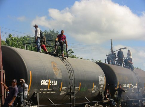 """Migrants travel on """"The Beast,"""" a train that takes them north through Mexico"""