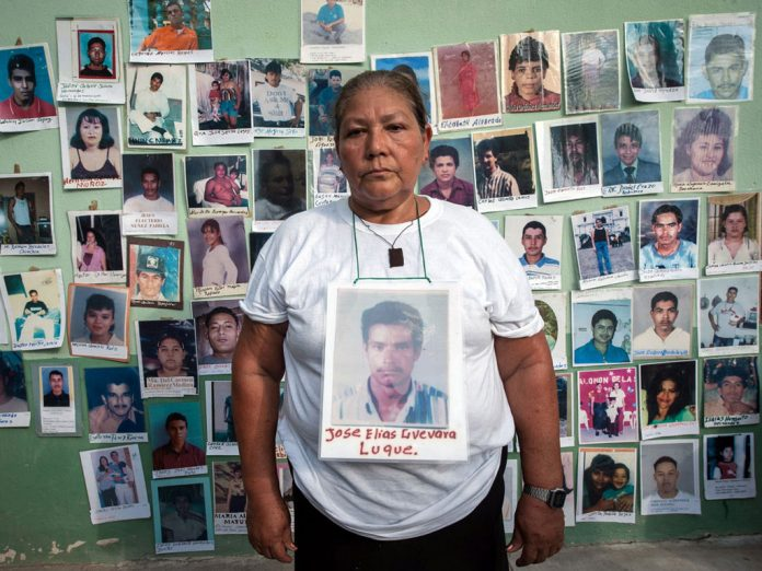 Pictures of missing migrants during a demonstration in Mexico City
