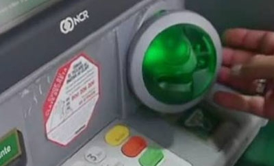 "A ""skimmer"" installed at an ATM"