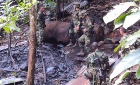 Colombian soldiers inspect an alleged FARC oil refinery
