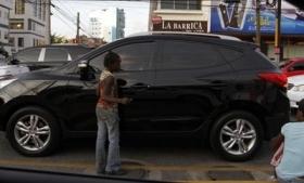 Haitian children beg on the streets of Santa Domingo