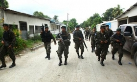 Soldiers patrol San Pedro Sula streets