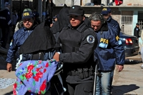 "Police transport one of the ""narco-wives"""