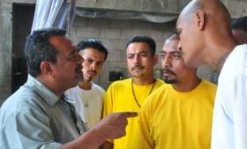 Truce mediator Raul Mijango with gang members