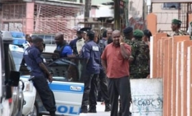 Trinidad police carry out a raid following gang violence