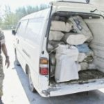 A Bahamas anti-drug officer with seized drugs