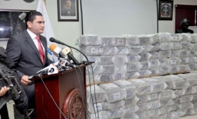A Dominican official displays the latest drug haul