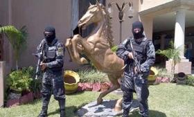 Honduras police guard a seized Cachiros' property