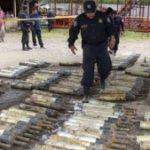 El Salvador police inspect the recovered grenades