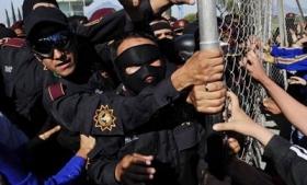 Police hold back relatives of 44 killed in Nuevo Leon prison