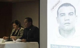 Guatemala's attorney general (far left) announces arrests