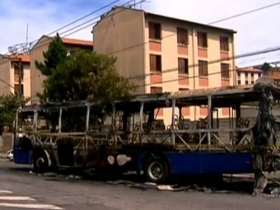 A bus torched in the aftermath of the killings