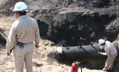 An illegal fuel siphon on a Pemex pipeline