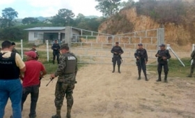 Honduras security officials guarding a drug lab