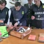 Police in Italy with the recovered drugs