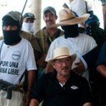 Vigilante leader Hipolito Mora (seated)