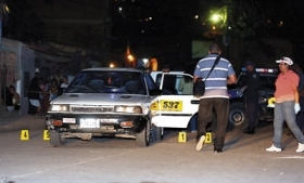 Bullet casings surround Honduran taxi cab