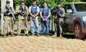 Two members of the gang with the seized drugs