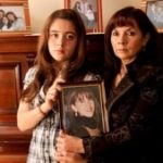 Susana Trimarco with a photo of her daughter, Marita
