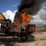 Mining equipment being burned in Peru
