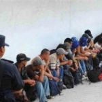 Migrants under guard in Mexico