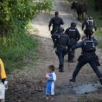 Federal police near a mass grave in Iguala