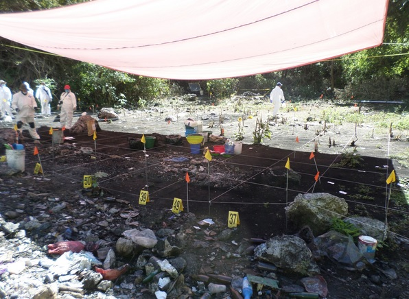 Investigators at the alleged crime scene
