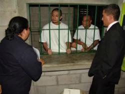 Government officials meet inmates at El Salvador's maximum-security prison