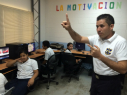 El Salvador policeman at a violence prevention class