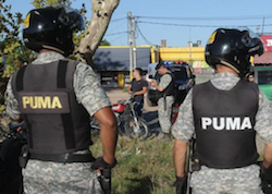 Police in Uruguay stopping a motorcycle rider during the operation
