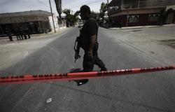 A policeman at a Juarez crime scene in 2010