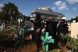 El Salvador police carry a colleague's casket