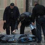Argentine investigators examine the body of a homicide victim