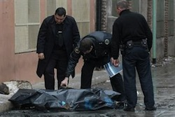 Argentine investigators examine the body of a homicide victim