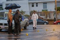 Costa Rica investigators at a murder scene