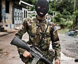 A Salvadoran soldier with his face covered