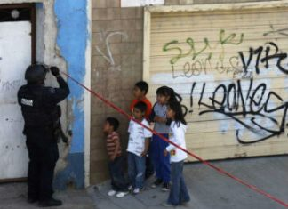 Children at a crime scene in Mexico