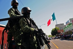 Mexican soldiers stand guard