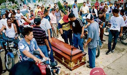 Armed bands ordered residents indoors during the funeral procession of a fallen leader