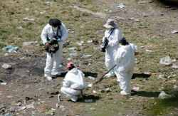 A forensic unit at the Cocula trash dump