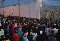 Onlookers outside Topo Chico prison