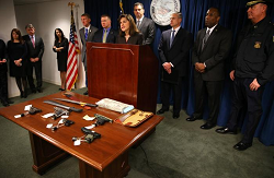 DOJ officials with weapons confiscated from the MS13