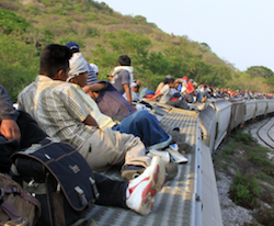 Central American migrants riding the