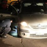 Argentina police inspect a vehicle used in an express kidnapping