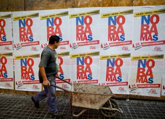 Posters protesting the Obamas' March 2016 visit to Argentina