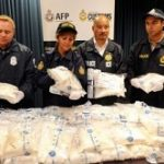 Australian officials with seized cocaine